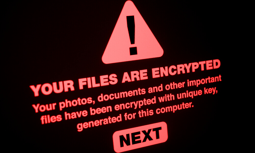 "Image of ransomware attack with a warning sign and the words: ""Your files are encrypted."""